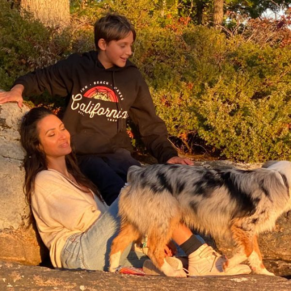 Sitara Hewitt and her son on a hike with their dog at sunset